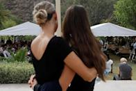Relatives embrace during the funeral service of Dawna Ray Langford, 43, and her sons Trevor and Rogan, who were killed by unknown assailants, to be buried at the cemetery in La Mora