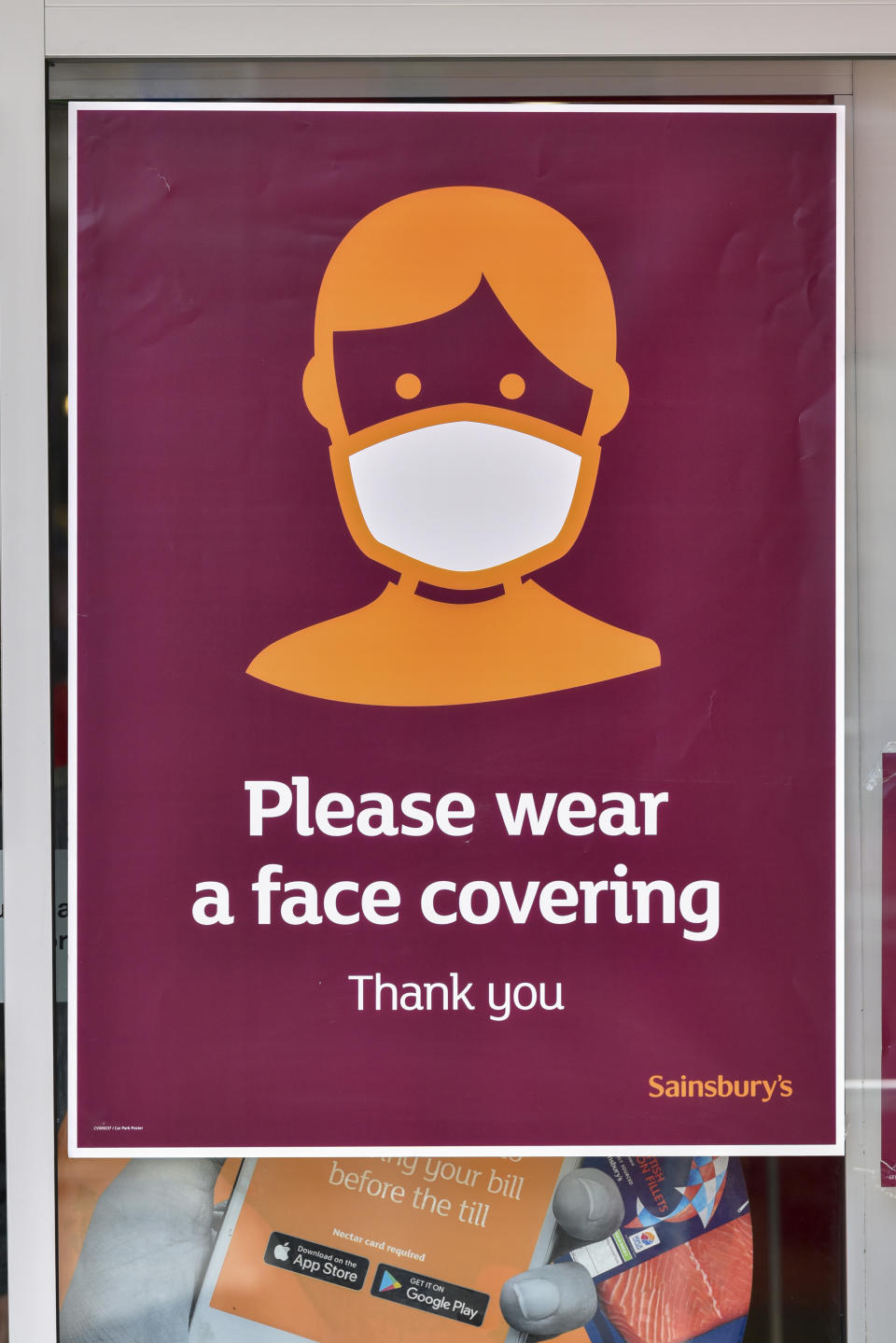 LONDON, UNITED KINGDOM - 2020/07/28: A sign advising customers to wear protective face covering is displayed at Sainsburys store. The Government has made it mandatory to wear face coverings on all public transport and in different places like shops, banks and post offices as well as shops, supermarkets, indoor shopping centres and stations in England. (Photo by Dave Rushen/SOPA Images/LightRocket via Getty Images)