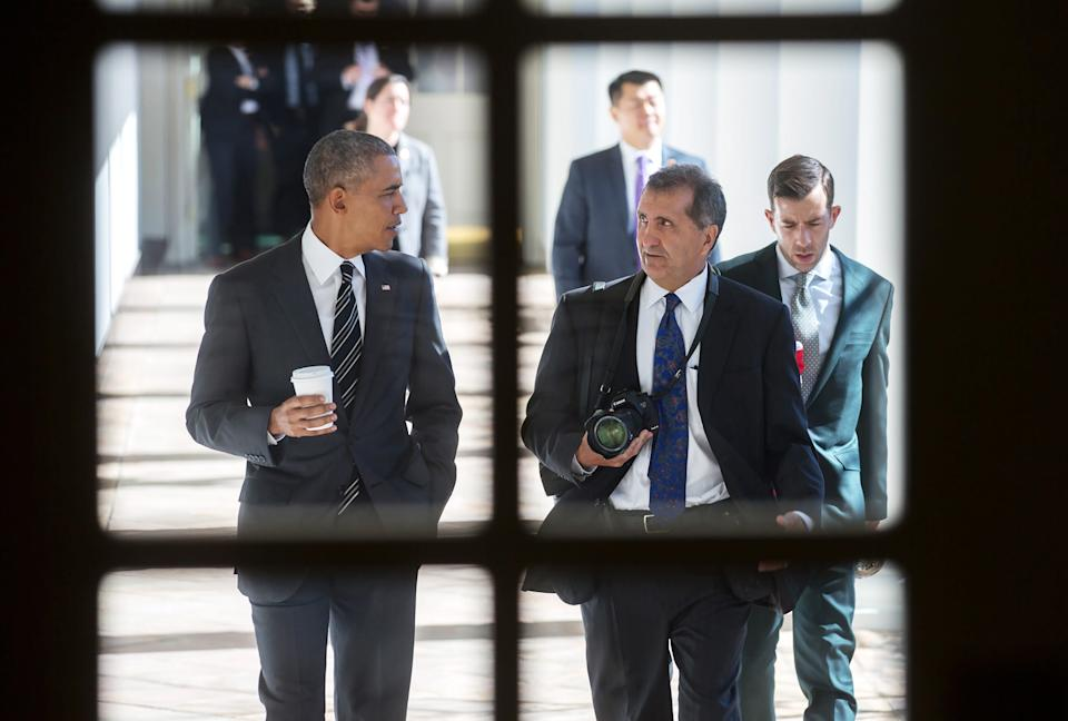 """President Barack Obama (left) walks along the West Colonnade of the White House with chief White House photographer Pete Souza, the subject of the documentary """"The Way I See It."""""""