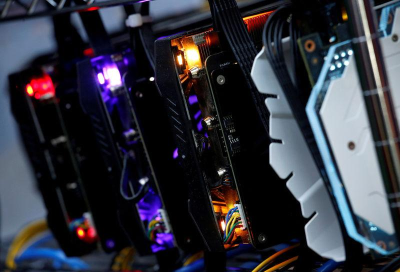 FILE PHOTO - High-end graphic cards are installed in a cryptocurrency mining computer at a computer mall in Hong Kong