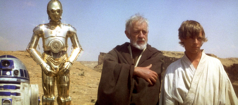 British actors Anthony Daniels, Alec Guinness and American Mark Hamill on the set of Star Wars: Episode IV - A New Hope written, directed and produced by Georges Lucas. (Photo by Sunset Boulevard/Corbis via Getty Images)