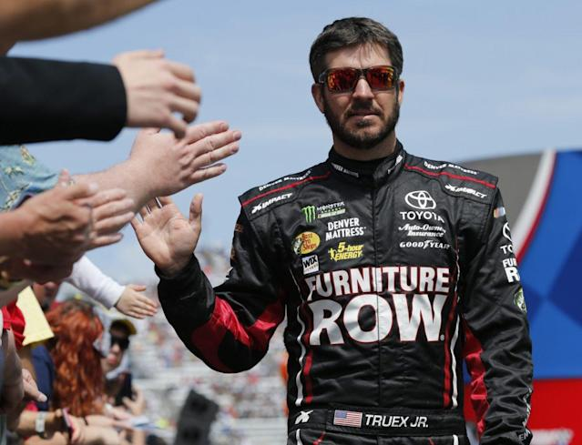 """<a class=""""link rapid-noclick-resp"""" href=""""/nascar/sprint/drivers/380/"""" data-ylk=""""slk:Martin Truex Jr."""">Martin Truex Jr.</a>, greets fans during driver introductions prior to the start of the NASCAR Cup Series race at Martinsville Speedway . (AP Photo/Steve Helber)"""