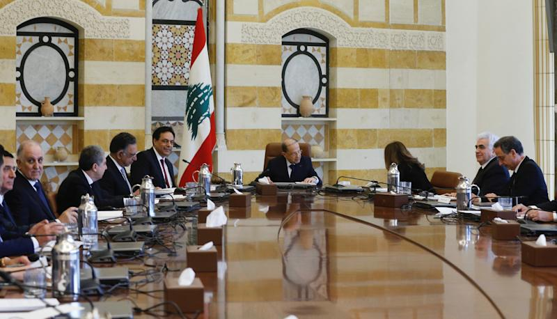 Lebanon's President Michel Aoun heads the first meeting of the new cabinet at the presidential palace in Baabda
