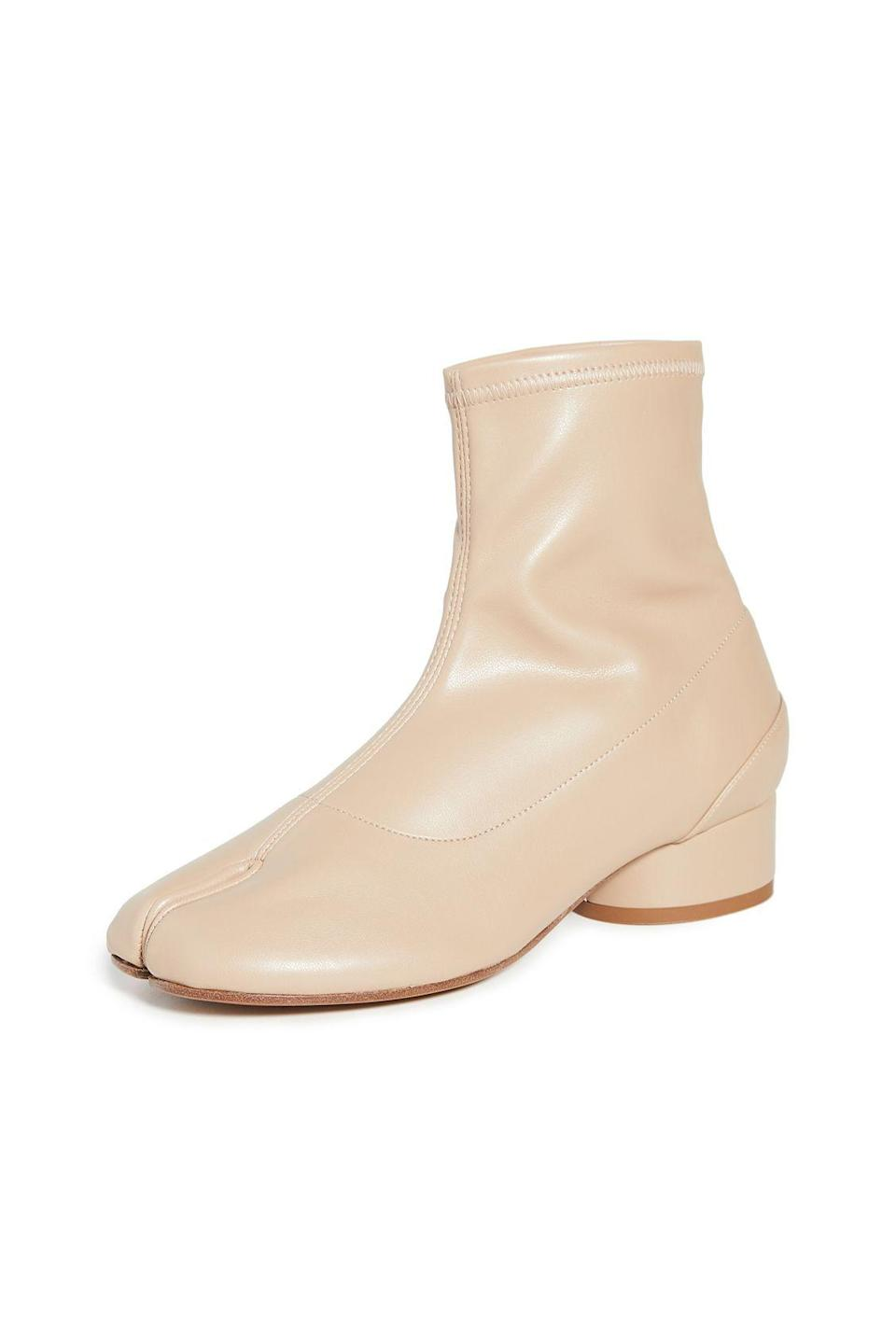 """<p><strong>Maison Margiela</strong></p><p>shopbop.com</p><p><strong>$895.00</strong></p><p><a href=""""https://go.redirectingat.com?id=74968X1596630&url=https%3A%2F%2Fwww.shopbop.com%2Ftabi-skin-bootie-maison-margiela%2Fvp%2Fv%3D1%2F1563518284.htm&sref=https%3A%2F%2Fwww.marieclaire.com%2Ffashion%2Fg33469548%2Fbest-ankle-boots-for-women%2F"""" rel=""""nofollow noopener"""" target=""""_blank"""" data-ylk=""""slk:SHOP IT"""" class=""""link rapid-noclick-resp"""">SHOP IT</a></p><p>For the ankle boot that will really draw some accolades, invest in Maison Margiela's iconic """"Tabi"""" booties. The split-toe design makes it unlike any other shoe you've ever worn.</p>"""