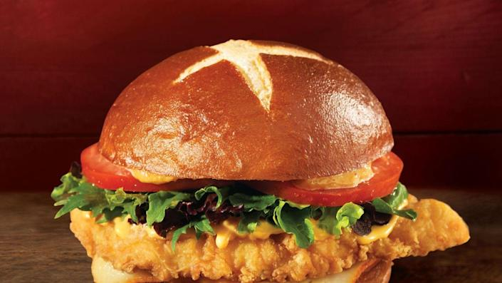 """<p>Yes, this is in fact the same caliber of a pub sandwich that you'll find at a local pub in Dublin, Ireland. This """"Fresh, Never Frozen"""" chain recently released their <a href=""""https://www.wendys.com/made-crave?gclid=CjwKCAjwiOv7BRBREiwAXHbv3G02MZPSS9c0-4JkuwXkAAud44AKQEZwr4aJun1aejXhS3bWzBqywxoCmScQAvD_BwE#chicken"""" rel=""""nofollow noopener"""" target=""""_blank"""" data-ylk=""""slk:Pretzel Bacon Pub Chicken Sandwich"""" class=""""link rapid-noclick-resp"""">Pretzel Bacon Pub Chicken Sandwich</a> and I hope they never remove it from the menu. Not only is the chicken crispy and juicy, but the unique condiments such as warm beer cheese sauce, applewood smoked bacon, smoky honey mustard and crispy fried onions just make it one-of-a-kind. And the best part? A pretzel bun, literally my dreams in the form of a sandwich. </p>"""