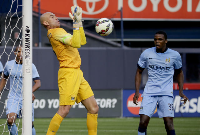 Manchester City goal keeper Willy Caballero blocks a shot by Liverpool in the first half of a Guinness International Champions Cup soccer tournament match, Wednesday, July 30, 2014, at Yankee Stadium in New York. (AP Photo/Julie Jacobson)