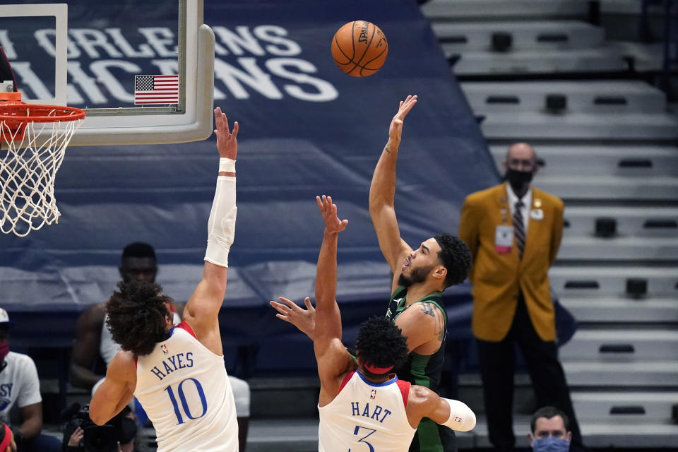 Boston Celtics forward Jayson Tatum shoots against New Orleans Pelicans center Jaxson Hayes (10) and guard Josh Hart (3) in the first half of an NBA basketball game in New Orleans, Sunday, Feb. 21, 2021. (AP Photo/Gerald Herbert)