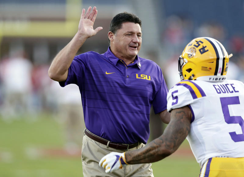"LSU head coach Ed Orgeron prepares to ""high five"" running back Derrius Guice (5) during pregame warmups of an NCAA college football game against Mississippi in Oxford, Miss., Saturday, Oct. 21, 2017. No. 24 LSU won 40-24. (AP Photo/Rogelio V. Solis)"