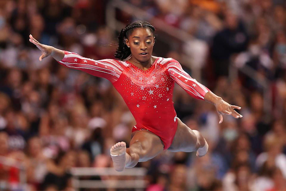 Simone Biles competes in the floor exercise during the Women's competition of the 2021 U.S. Gymnastics Olympic Trials at America's Center on June 27, 2021 in St Louis, Missouri.