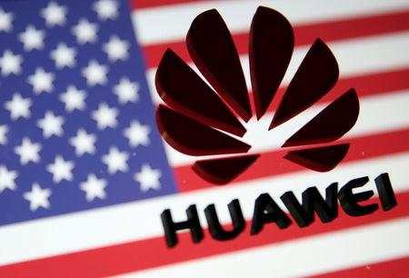 FILE PHOTO: A 3D printed Huawei logo is placed on glass above displayed U.S. flag in this illustration taken January 29, 2019. REUTERS/Dado Ruvic/Illustration/File Photo