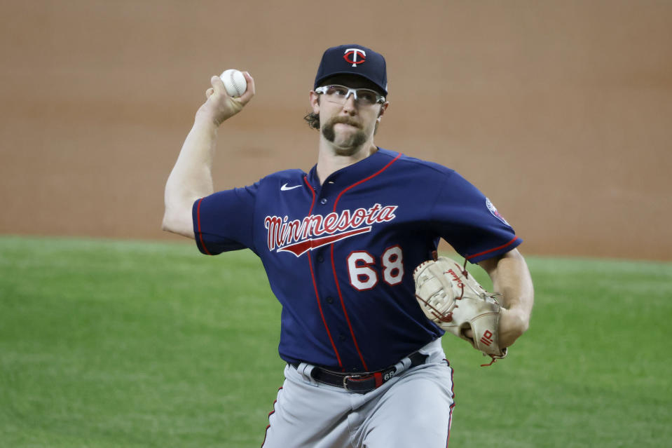 Minnesota Twins starting pitcher Randy Dobnak throws against the Texas Rangers during the first inning of a baseball game Saturday, June 19, 2021, in Arlington, Texas. (AP Photo/Michael Ainsworth)