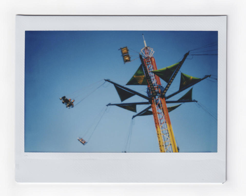 People spin around in an amusement ride at the annual Mississippi State Fair, on Wednesday, Oct. 7, 2020, in Jackson, Miss. (AP Photo/Wong Maye-E)