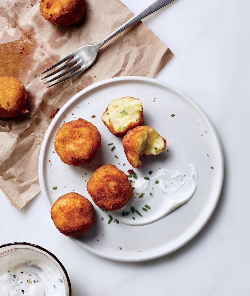 """We thought mashed potatoes' stock plummeted on Day 2—until we had these croquettes. Crispy yet creamy, potatoes might be better the second time around. <a href=""""https://www.bonappetit.com/recipe/mashed-potato-croquettes?mbid=synd_yahoo_rss"""">See recipe.</a>"""