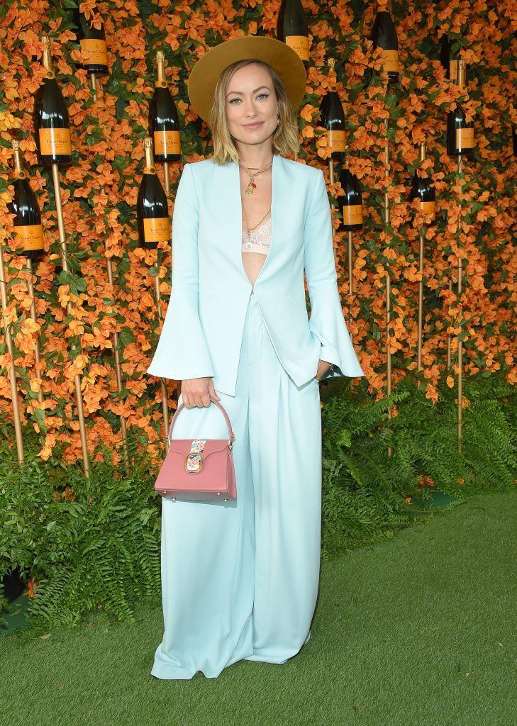 <p>Olivia Wilde also opted for blue at the event in a bell-sleeve co-ord with a pink miniature handbag thrown in for an Insta-worthy pop of colour. <em>[Photo: Getty]</em> </p>