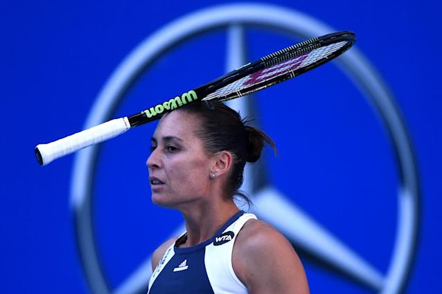 Flavia Pennetta of Italy reacts after losing a point against Anastasia Pavlyuchenkova of Russia during their women's singles third round match at the China Open tennis tournament in Beijing on October 8, 2015. AFP PHOTO / WANG ZHAO (AFP Photo/WANG ZHAO)