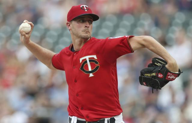 Minnesota Twins pitcher Jake Odorizzi throws against the Oakland Athletics in the first inning of a baseball game Friday, July 19, 2019, in Minneapolis. (AP Photo/Jim Mone)