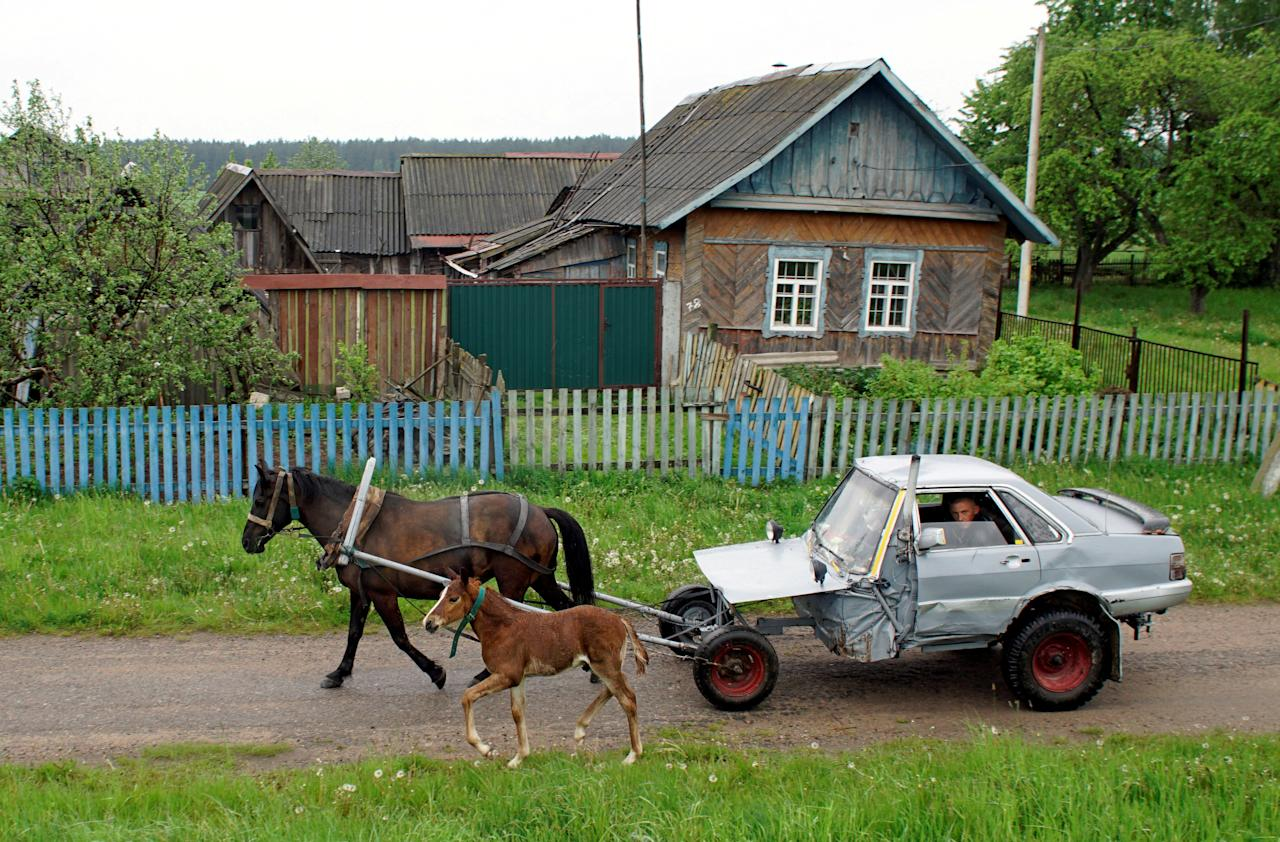 Belarusian shepherd Alexey Usikov, 33, drives a horse-drawn carriage, equipped with a battery, head lights, small potbelly stove, which he crafted out of an old Audi-80 calling it jokingly Audi-40 as he used only a half of the car, in the village of Knyazhytsy, Belarus May 28, 2020. Picture taken May 28, 2020.  REUTERS/Vasily Fedosenko     TPX IMAGES OF THE DAY