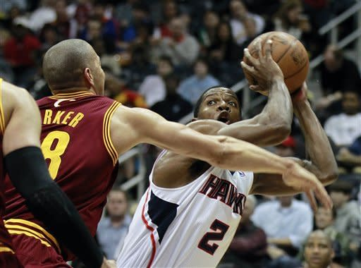 Atlanta Hawks shooting guard Joe Johnson (2) looks for a shot as Cleveland Cavaliers shooting guard Anthony Parker (18) defends in the first half of an NBA basketball game on Saturday, Jan. 21, 2012, in Atlanta. (AP Photo/John Bazemore)