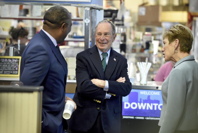 Democratic presidential candidate and former New York Mayor Michael Bloomberg, middle, and Augusta, Ga., Mayor Hardie Davis, left, chat with a woman at the New Moon Cafe in Augusta, Ga., Friday, Dec. 6, 2019. (Michael Holahan/The Augusta Chronicle via AP)
