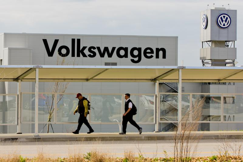 Workers walk by the Volkswagen AG plant in Chattanooga, Tenn., on Wednesday, March 21, 2012. Tennessee Gov. Bill Haslam, VW Chattanooga CEO and Chairman Frank Fisher and other VW executives are scheduled to attend a news conference at a VW conference center about an employees related announcement Thursday March 22, 2012. (AP Photo/Erik Schelzig)