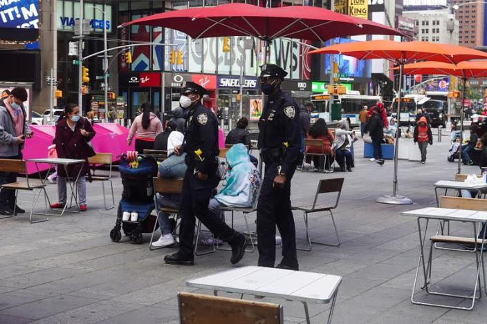 FILE PHOTO: Police officers walk through Times Square in New York City