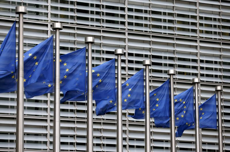 FILE PHOTO: Picture shows European Union flags fluttering outside the EU Commission headquarters in Brussels
