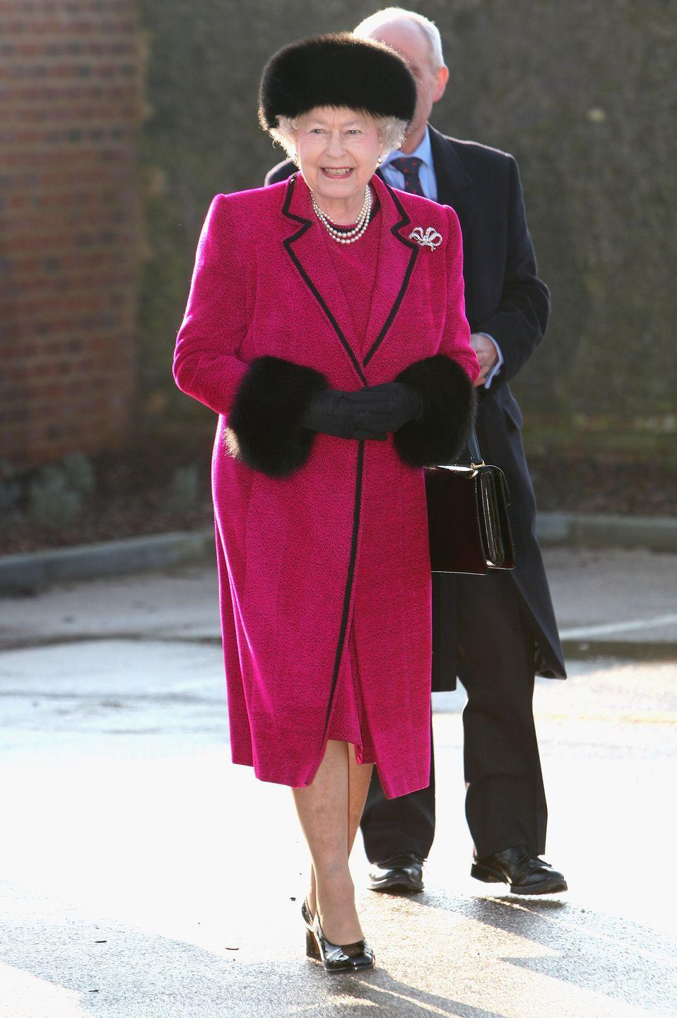 <p>While opening the Carole Brown Health Centre on February 3, 2009, Queen Elizabeth wore a magenta coat with fur trim and a matching dress.</p>