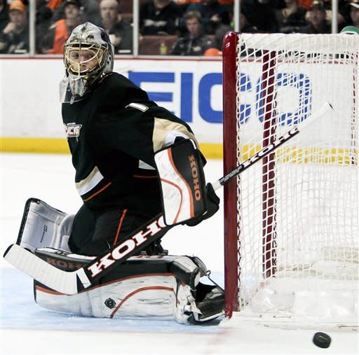 Anaheim Ducks goalie Jonas Hiller, from Switzerland, makes a save during the first period of an NHL hockey game against the Ottawa Senators, Saturday, Jan. 21, 2012, in Anaheim, Calif. (AP Photo/Bret Hartman)