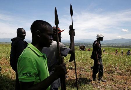 Members of the Luo ethnic group hold spears near the town of Muhoroni in Kisumu County
