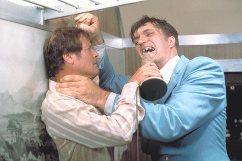 """This undated publicity photo provided by United Artists and Danjaq, LLC shows Richard Kiel, right, as Jaws and Roger Moore, as James Bond, fighting in the 1977 film, """"The Spy Who Loved Me."""" Those teeth could do some serious damage. The film is included in the MGM and 20th Century Fox Home Entertainment Blu-Ray """"Bond 50"""" anniversary set. (AP Photo/United Artists and Danjaq, LLC)"""