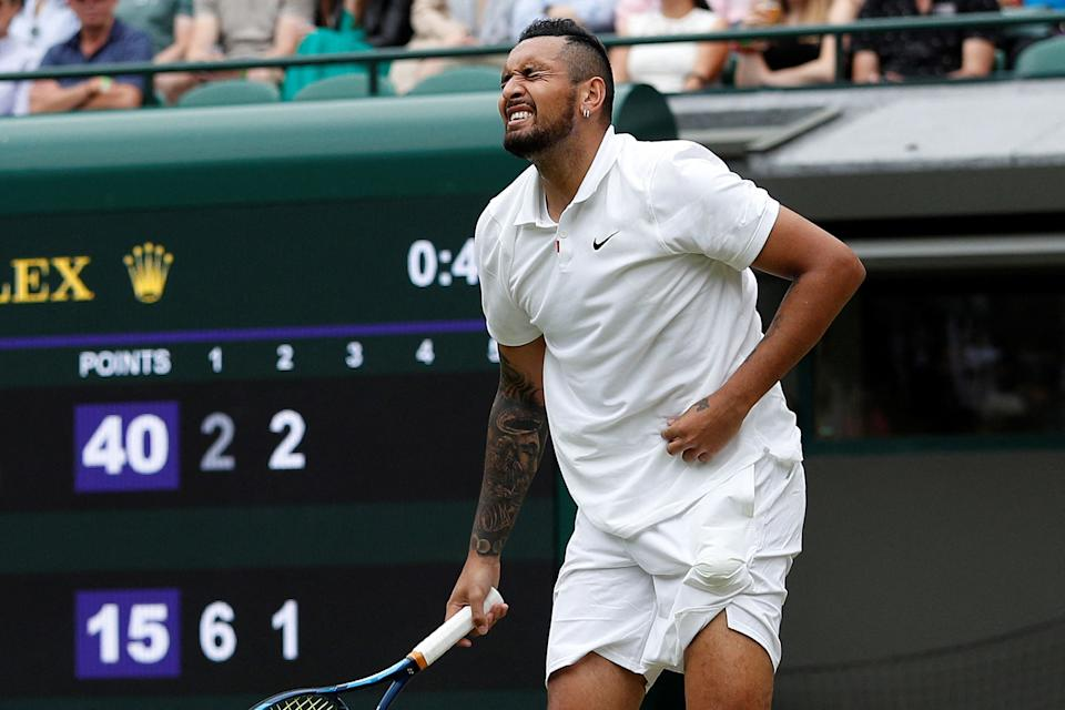 Nick Kyrgios (pictured) reacts in pain after serving againsT Felix Auger-Aliassime.