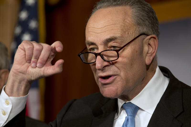 Sen. Charles Schumer, D-NY, gestures to show how close he says the Speaker and the President are to a deal on the fiscal cliff, during a news conference at the U.S. Capitol in Washington, on Thursday, Dec. 20, 2012. (AP Photo/Jacquelyn Martin)