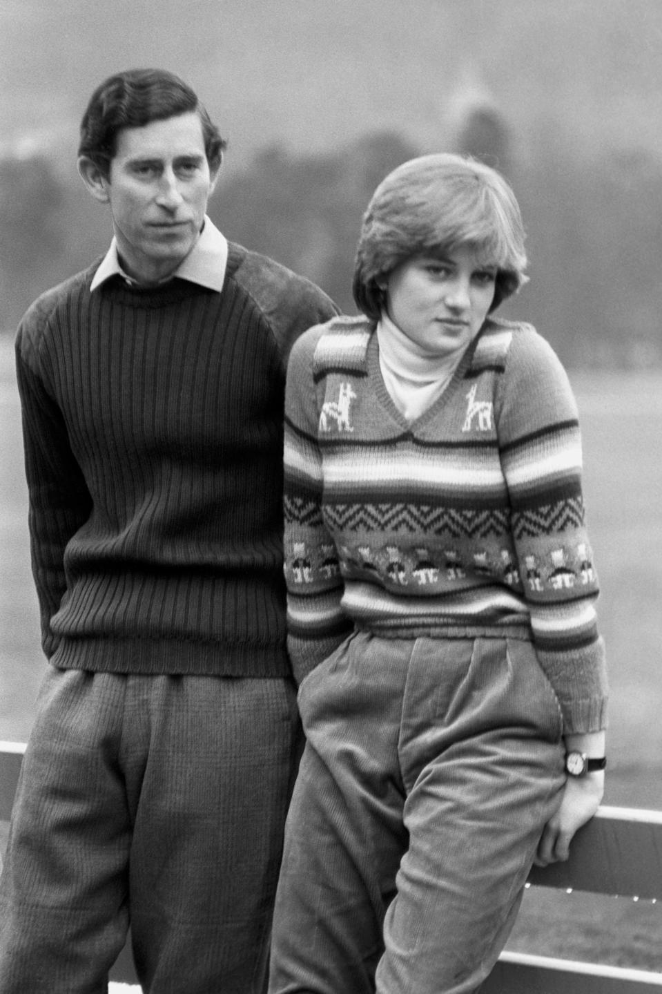 The casually clad Prince Charles of Wales and his fiance Lady Diana Spencer, relaxing on a fence at Balmoral on May 6, 1981, during their Scottish holiday.
