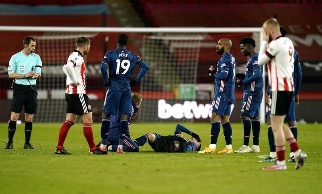 Gabriel Martinelli, centre, receives treatment shortly before his goal