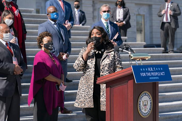 U.S. Alabama Rep. Terri Sewell recalled the work of the late U.S. Rep. John Lewis as Democrats gather for a press conference to urge passage of H.R. 1, the For the People Act of 2021, at the Capitol in Washington, Wednesday, March 3, 2021.  (AP Photo/J. Scott