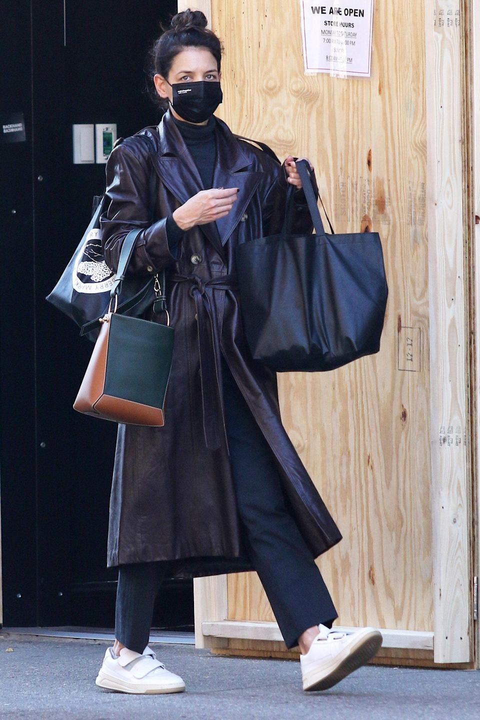 <p>Katie Holmes carries a handful of bags while running errands on Wednesday in N.Y.C.</p>