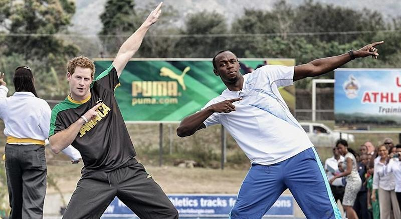Prince Harry with Usain Bolt. Photo: Getty Images.