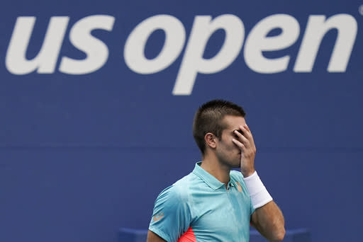 Borna Coric, of Croatia, reacts during match against Alexander Zverev, of Germany, during the quarterfinals of the US Open tennis championships, Tuesday, Sept. 8, 2020, in New York. (AP Photo/Seth Wenig)