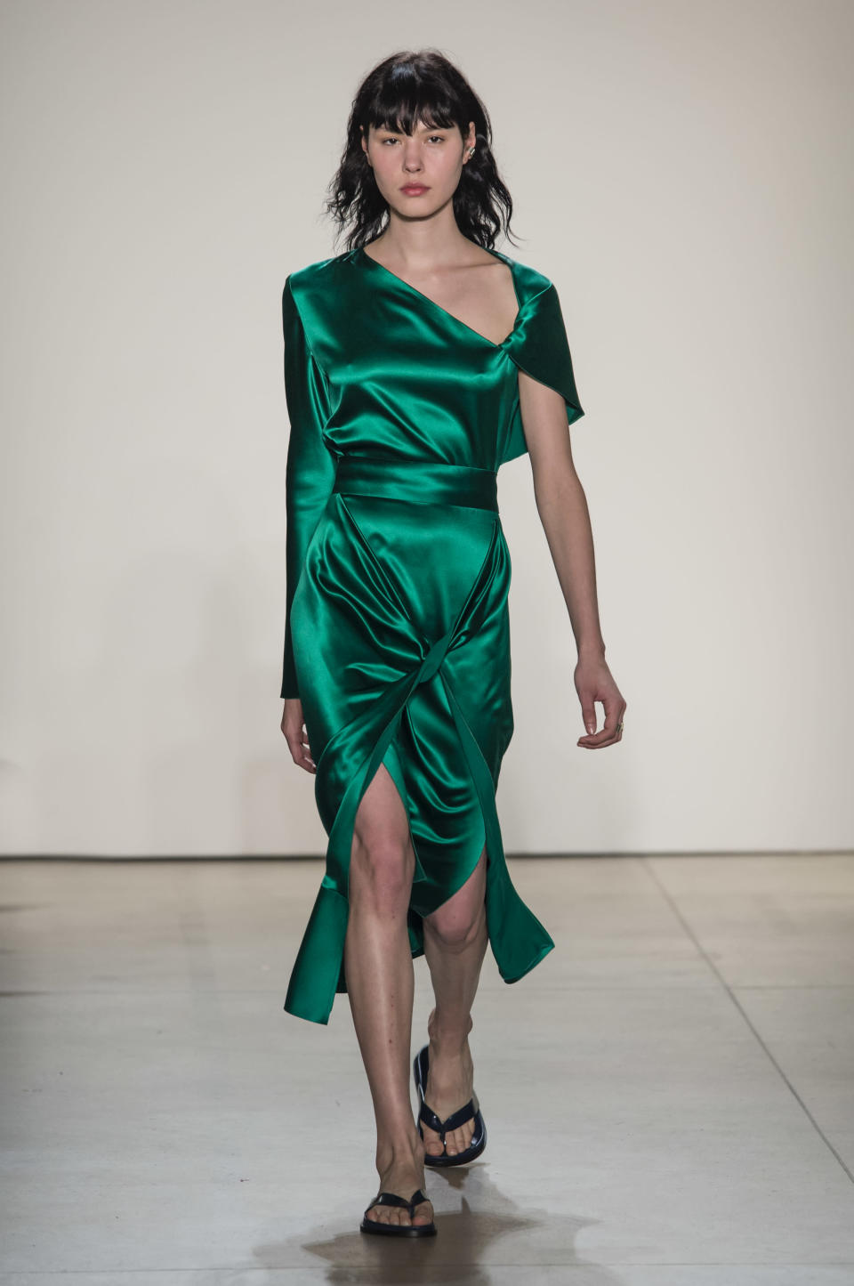<p><i>Model wears an emerald green silk dress with high slit from the SS18 Dion Lee collection. (Photo: ImaxTree) </i></p>