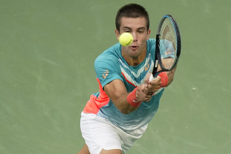 Borna Coric, of Croatia, returns a shot to Jordan Thompson, of Australia, during the fourth round of the US Open tennis championships, Sunday, Sept. 6, 2020, in New York. (AP Photo/Frank Franklin II)