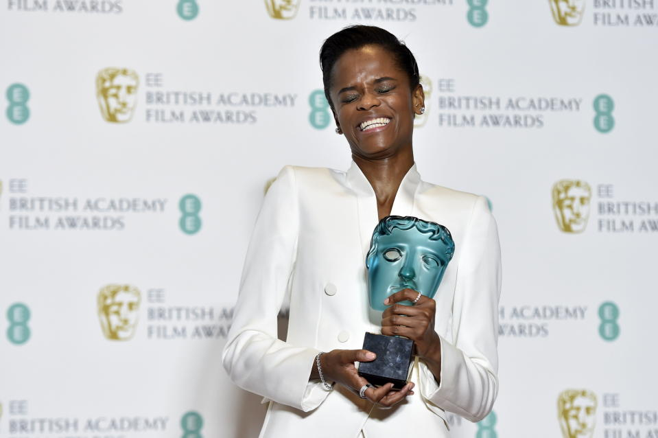Letitia Wright poses with her Rising Star award in the press room during the 72nd annual British Academy Film Awards (Credit: EFE/EPA/NIK HALLEN)