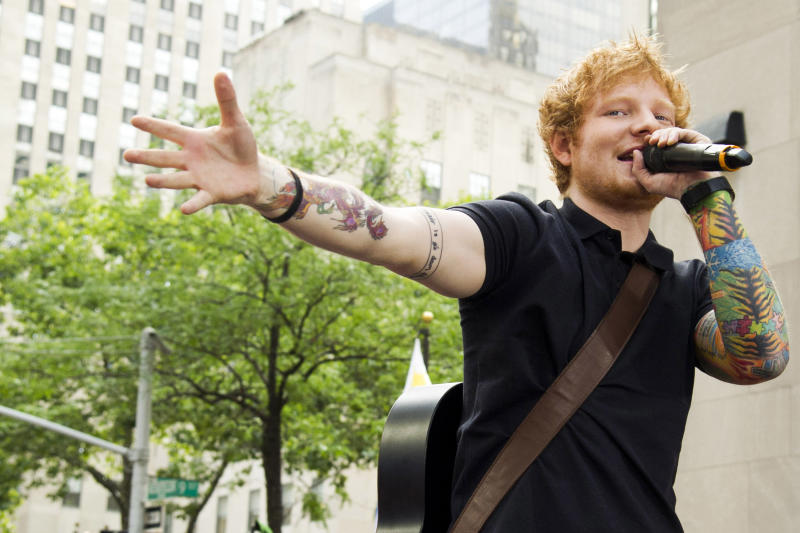 """FILE - This July 12, 2013 file photo shows Ed Sheeran performing on NBC's """"Today"""" show in New York. Sheeran is part of a breed of newer and lesser known acts who are able to sell out top venues, even if they aren't selling millions of albums and singles, or dominating with chart-topping tracks and radio airplay. (Photo by Charles Sykes/Invision/AP, File)"""