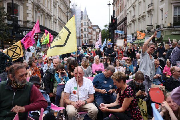 Extinction Rebellion protesters take part in a protest in the Covent Garden area on August 23, 2021 (Photo: Dan Kitwood via Getty Images)