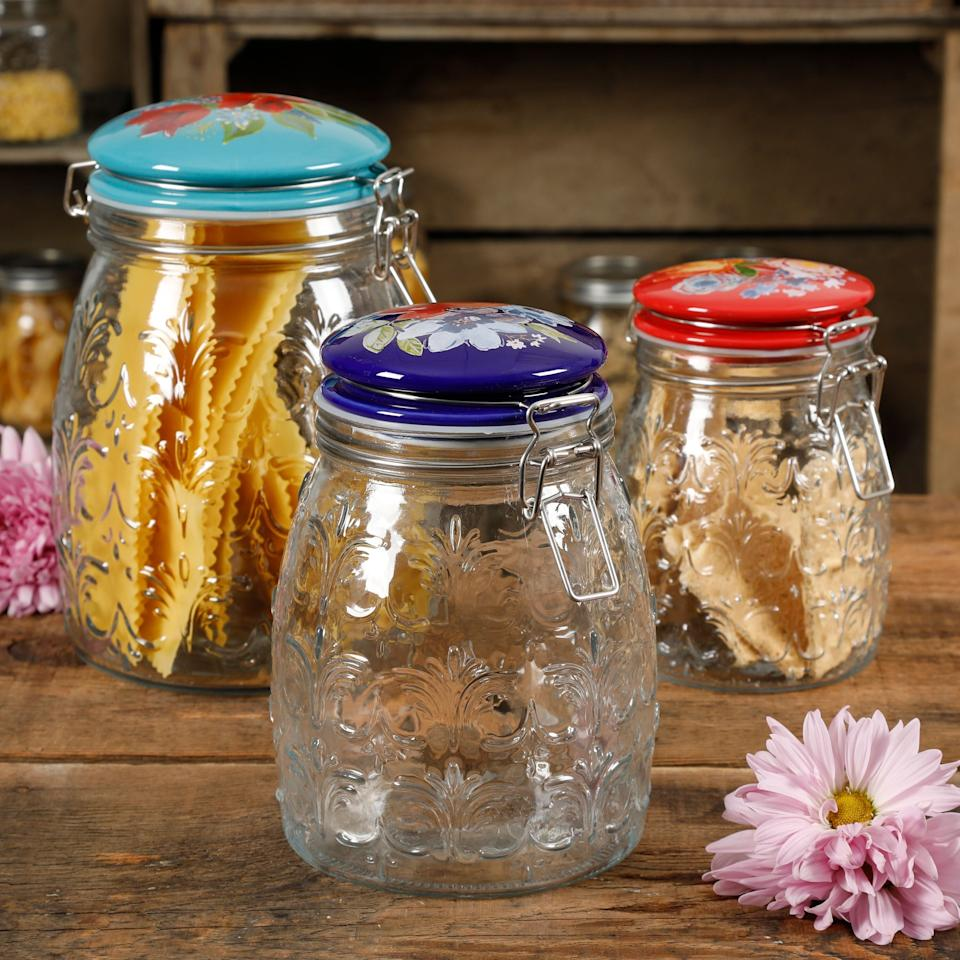 """Pasta, nuts and candies— these are just a few of the things that you can put into these jars. The jars feature bold colors and painted bouquets that'll brighten up your countertops. <a href=""""https://fave.co/31EtYR1"""" target=""""_blank"""" rel=""""noopener noreferrer"""">Find the set for $24 at Walmart</a>."""