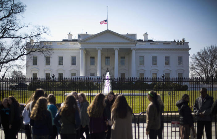 <p>The U.S. flag is lowered to half-staff above the White House in Washington on Monday after President Obama ordered that flags be lowered at all government buildings in honor of the death of Nancy Reagan. <i>(Photo: Pablo Martinez Monsivais/AP)</i></p>