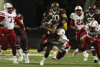 Minnesota running back Rodney Smith stays on his feet as Nebraska linebacker Mohamed Barry tries to tackle him during an NCAA college football game Saturday, Oct. 12, 2019, in Minneapolis. (AP Photo/Stacy Bengs)