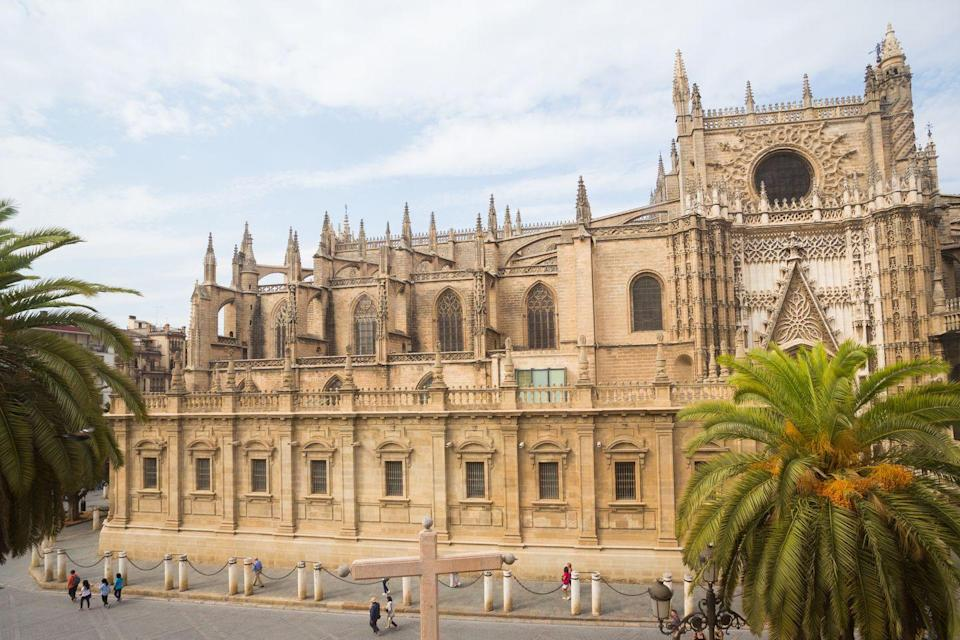 <p>Seville Cathedral is the largest Gothic edifice in the world, reflecting the country's Golden Age of colonization in the New World, Islamic influence, and religious power. Built on top of a former mosque, construction on this behemoth began at the turn of the 15th century and spanned seven centuries. Its strong ties to New World discovery makes it a natural home for many of the early explorers' precious documents, and it's even the site of Christopher Columbus's tomb.</p>