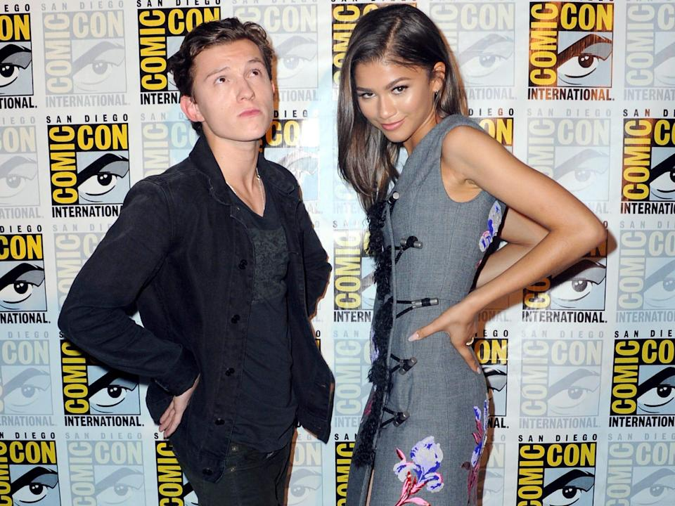 Tom Holland and Zendaya posing together at San Diego Comic-Con in July 2016.