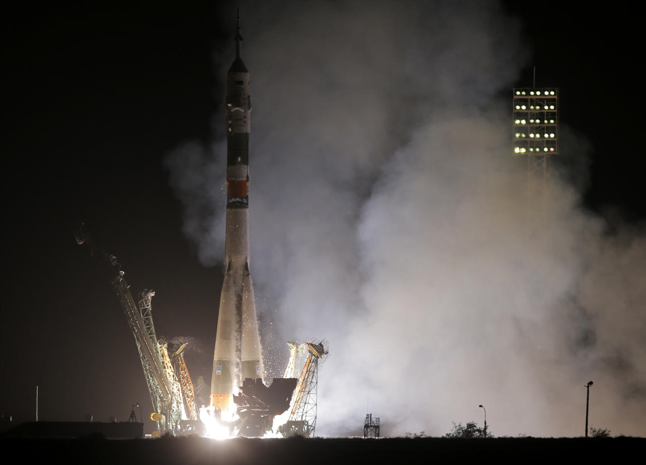 The Soyuz-FG rocket booster with Soyuz TMA-13M space ship carrying a new crew to the International Space Station, ISS, blasts off at the Russian leased Baikonur cosmodrome, Kazakhstan, Thursday, May 29, 2014. The Russian rocket carries European Space Agency's astronaut Alexander Gerst, Russian cosmonaut Maxim Suraev, and NASA astronaut Reid Wiseman. (AP Photo/Dmitry Lovetsky)