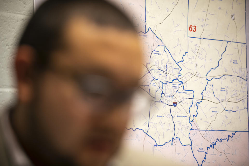 Ricky Hurtado, a Democratic candidate for the North Carolina state house, strategizes inside his campaign headquarters, in Graham, N.C., Tuesday, March 10, 2020, in front of a map of Alamance County. He is the first Latino candidate to run for North Carolina's House of Representatives. (AP Photo/Jacquelyn Martin)
